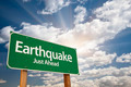 Earthquake Green Road Sign with Dramatic Clouds and Sky. - PhotoDune Item for Sale