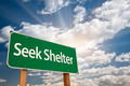 Seek Shelter Green Road Sign with Dramatic Clouds and Sky. - PhotoDune Item for Sale