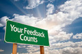 Your Feedback Counts Green Road Sign with Dramatic Clouds and Sky. - PhotoDune Item for Sale