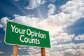 Your Opinion Counts Green Road Sign with Dramatic Clouds and Sky. - PhotoDune Item for Sale