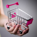 pink shopping cart in woman hand - PhotoDune Item for Sale
