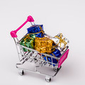 Christmas gifts in shopping trolley, isolated on white - PhotoDune Item for Sale