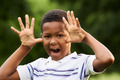 Happy african boy making a grimace at camera - PhotoDune Item for Sale