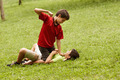 Violent kid fighting and hitting scared boy in park - PhotoDune Item for Sale