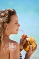 Portrait of woman relaxing with cocktail at cuban beach - PhotoDune Item for Sale