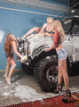 Attractive young women washing offroad car by sponge - PhotoDune Item for Sale