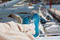 Human legs in pants and bright blue topsiders on yacht - PhotoDune Item for Sale