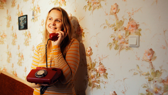 Happy Young Woman Receving A Call At Home
