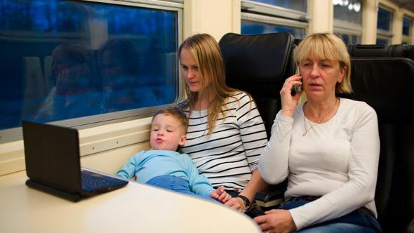 Son With Mother Watching Video In Train