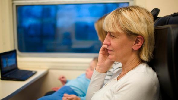 Woman In The Train Having A Phone Talk