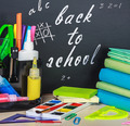 school stationery laid on a background of chalkboard - PhotoDune Item for Sale