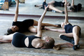Three ballet dancers on the floor during rehearsal - PhotoDune Item for Sale