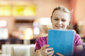 Young happy woman in cafe with tablet PC - PhotoDune Item for Sale