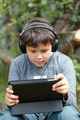 Teen boy in headphones with pad - PhotoDune Item for Sale
