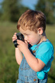 Little child taking pictures outdoor - PhotoDune Item for Sale