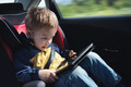 Child in the car with tablet PC - PhotoDune Item for Sale