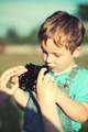 Mother helping her son to make his first photos - PhotoDune Item for Sale