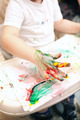 Boy painting with finger-paints - PhotoDune Item for Sale