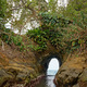 Natural tunnel in the rock dug by the sea - PhotoDune Item for Sale