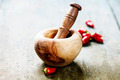 Wooden Mortar and Pestle and chilli peppers - PhotoDune Item for Sale