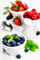 Berries in bowls  on Wooden Background. - PhotoDune Item for Sale