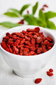 white bowl with goji berries on the table - PhotoDune Item for Sale