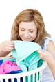 Charming woman doing laundry