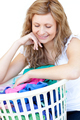 Smiling woman doing laundry