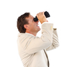 Handsome businessman searching for something with binoculars