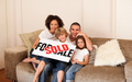 Cute family sitting on a sofa at home