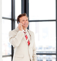 Happy mature businessman on phone
