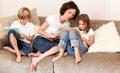 Charming family sitting on a sofa at home