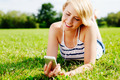 Smiling woman relaxing on the grass - PhotoDune Item for Sale