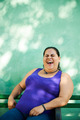 Portrait of fat woman looking at camera and smiling - PhotoDune Item for Sale