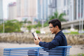 Portrait of asian office worker with ipad on bench - PhotoDune Item for Sale