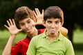 Happy hispanic boys making a grimace at camera - PhotoDune Item for Sale