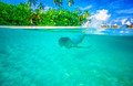 Swimming near tropical island - PhotoDune Item for Sale