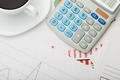 Coffee cup over some financial documents - view from top - PhotoDune Item for Sale
