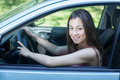 Beautiful Young Woman Driving a Car - PhotoDune Item for Sale