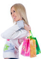 Young smiling woman with shopping bags looks sideware over white background - PhotoDune Item for Sale