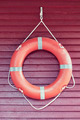 Life buoy on wooded wall - PhotoDune Item for Sale
