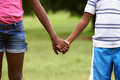 Children in love black boy and girl holding hands - PhotoDune Item for Sale