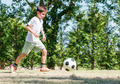 Child playing football in a stadium - PhotoDune Item for Sale