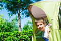 Child peeks from a tent - PhotoDune Item for Sale