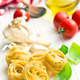 italian pasta tagliatelle, tomatoes and basil leaves - PhotoDune Item for Sale