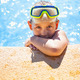 Happy girl with goggles in swimming pool - PhotoDune Item for Sale