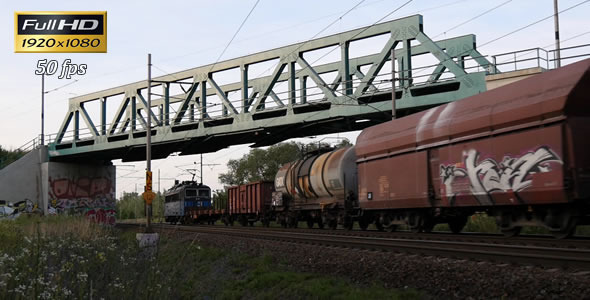 Freight Train Passes Under the Bridge 2