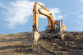 Big excavator on construction site - PhotoDune Item for Sale