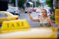 people travelling-business woman stopping yellow taxi - PhotoDune Item for Sale