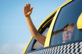 woman in taxi waving hand out of car window - PhotoDune Item for Sale